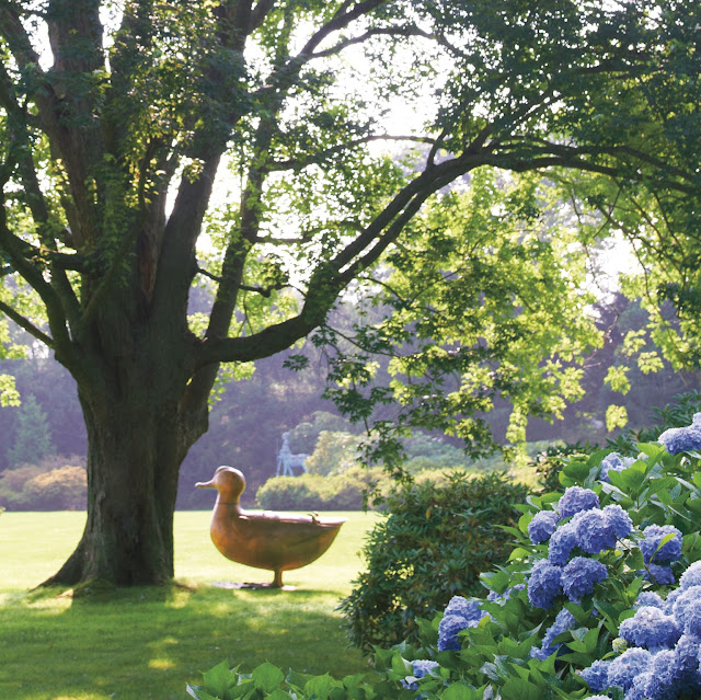 Hamptons garden of Peter Marino with Lalanne duck sculpture