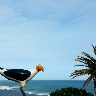 View of the sea, with a slightly deranged-looking wooden seagull in the foreground.