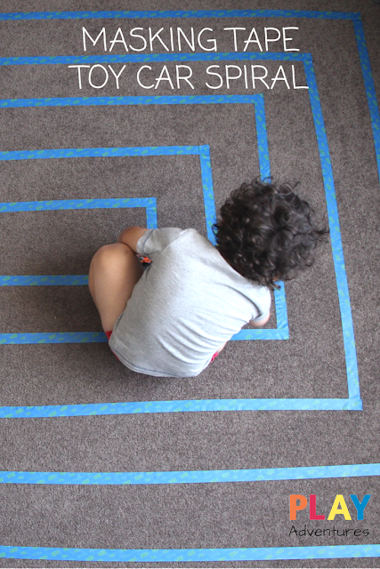 A fantastic activity for car obsessed kids. A spiral car track made out of masking tape!