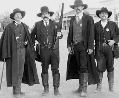 Pictured left Doc Holliday with Wyatt Earp and his brothers.