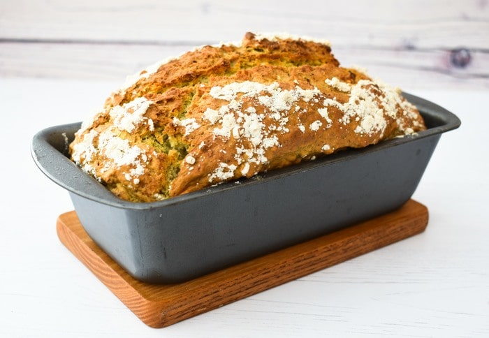 A well risen Pesto & Garlic Beer Bread in a loaf tin