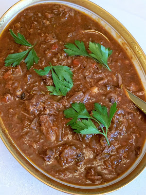 beef short ribs, tomato sauce, red wine, roasted garlic