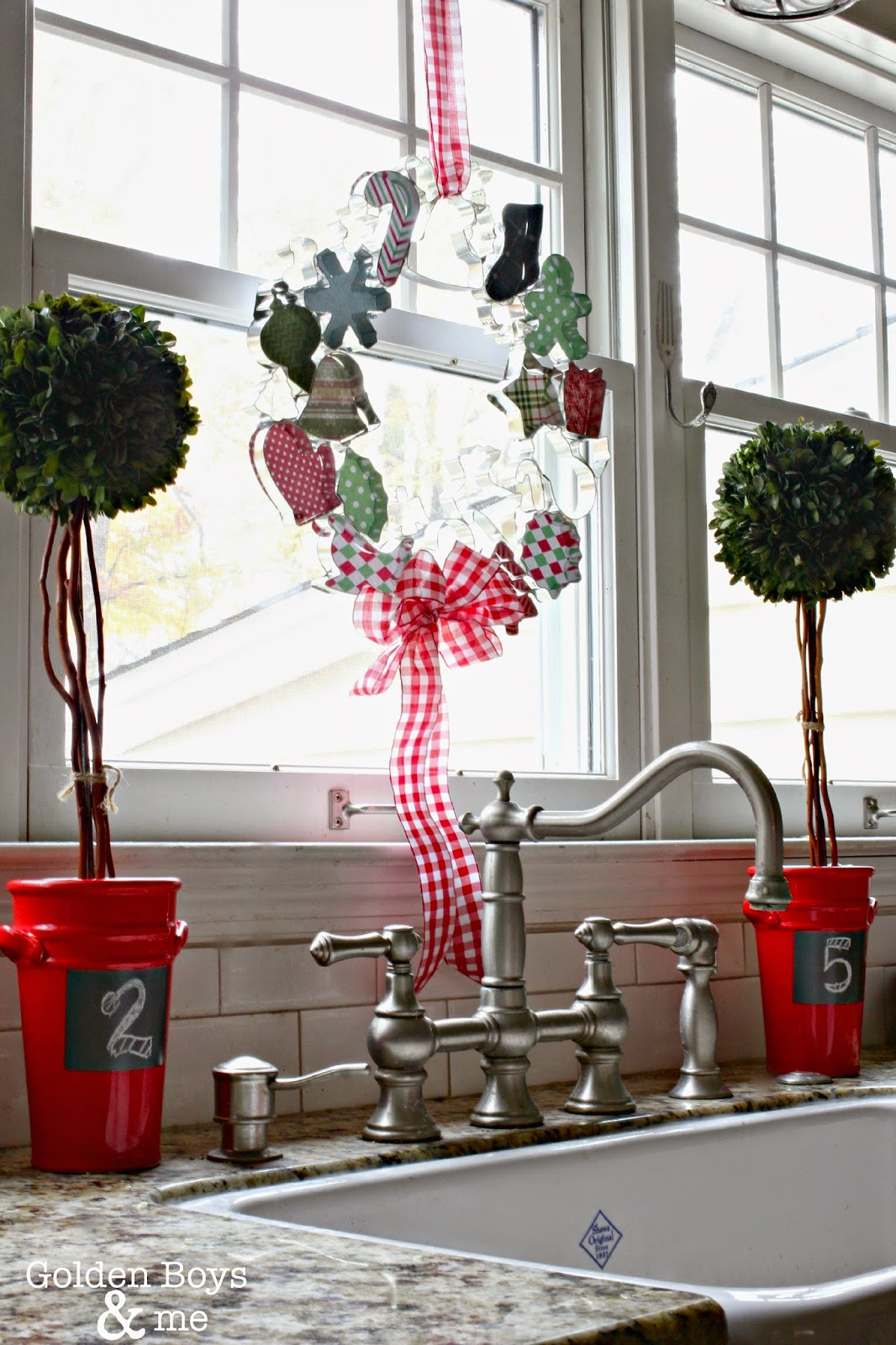 Cookie Cutter wreath over sink in Christmas decor with preserved boxwood topiaries-www.goldenboysandme.com