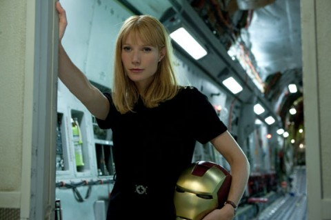 Gwyneth Paltrow holding a helmet in Iron Man 2 movieloversreviews.filminspector.com