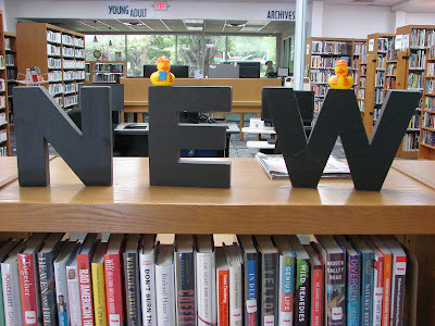 2 duckies on NEW sign letters in library