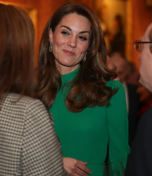 Kate Middleton wore a new emerald-green dress by Emilia Wickstead. The Duchess of Cornwall and First Lady Melania Trump