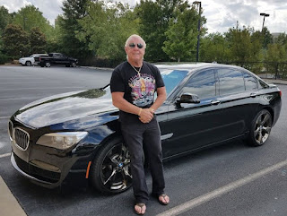 Jackie Beems' with her ex-husband Flair posing for picture with car