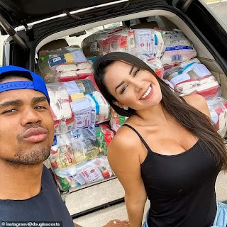 Juventus star Douglas Costa and his girlfriend help those in need in Brazil