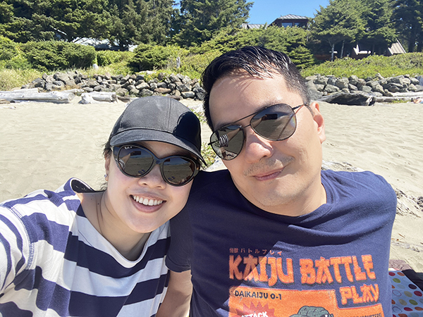 Selfie of Solo Lisa and her husband on Chesterman Beach, Tofino.