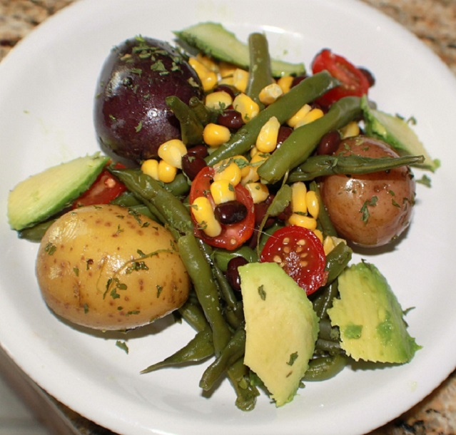 this is how to make a southwest salad with beans, avocado and corn