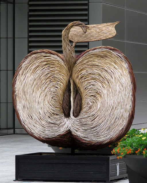 Broadgate Apple by Tom Hare, site-specific woven willow sculpture , Finsbury Avenue Square, Broadgate, London