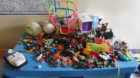 Extreme knick knacks Heap of small toys on a chest of drawers