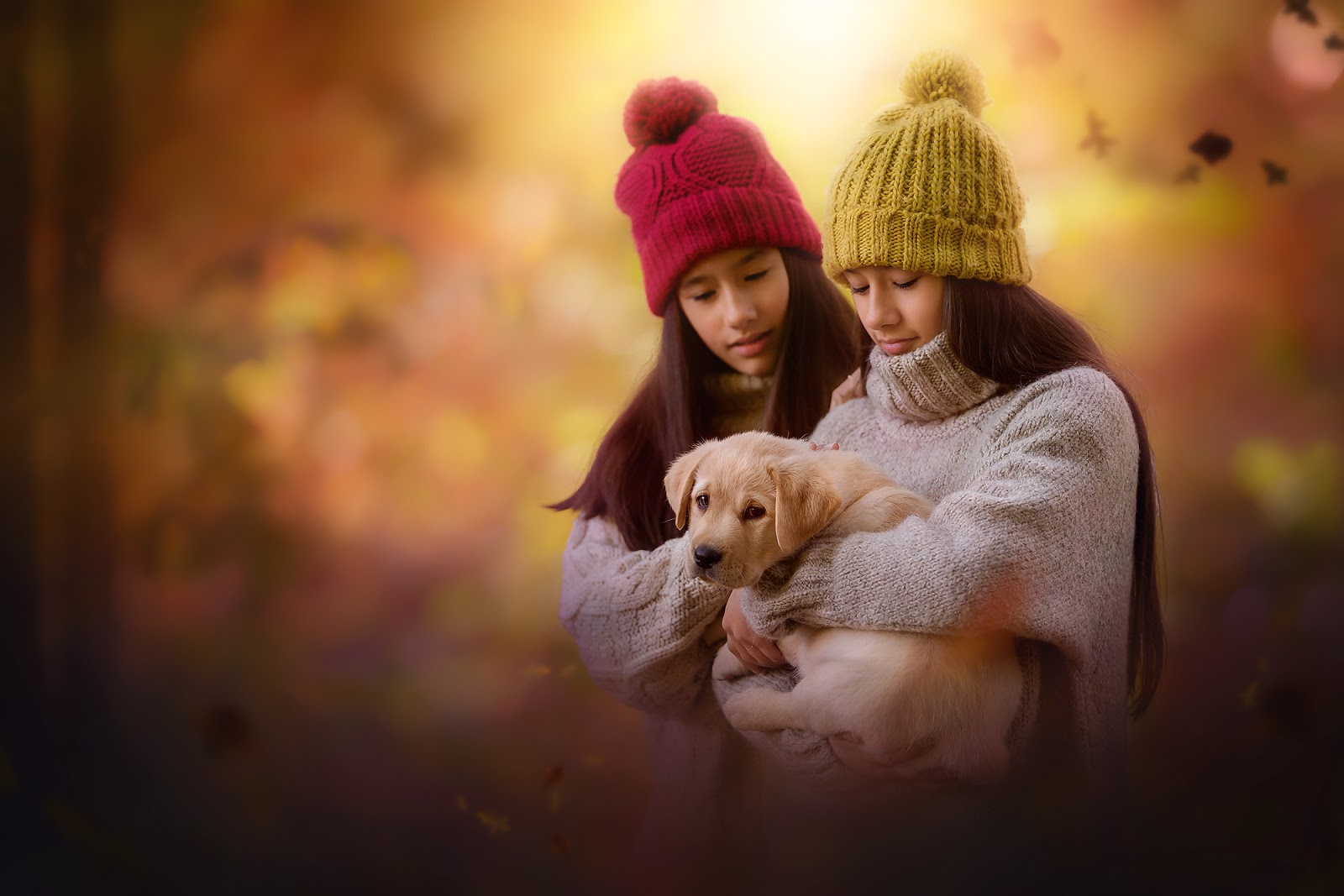 Canon 5d mark III portrait of two gorgeous asian girls holding a puppy in an enchanted autumn forest by Willie kers
