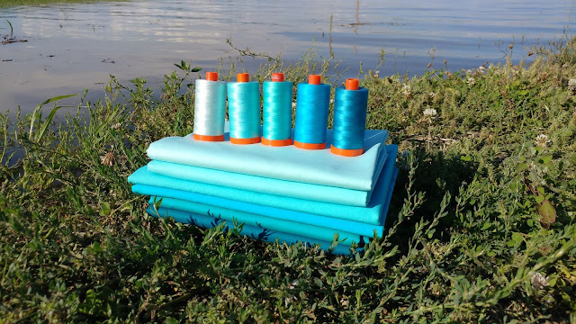 Kona solids and Aurifil thread in ombre aqua, turquoise, and teal