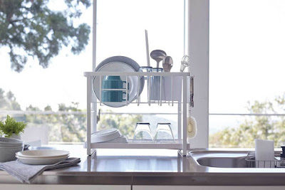 two-tier dish rack sitting on a counter