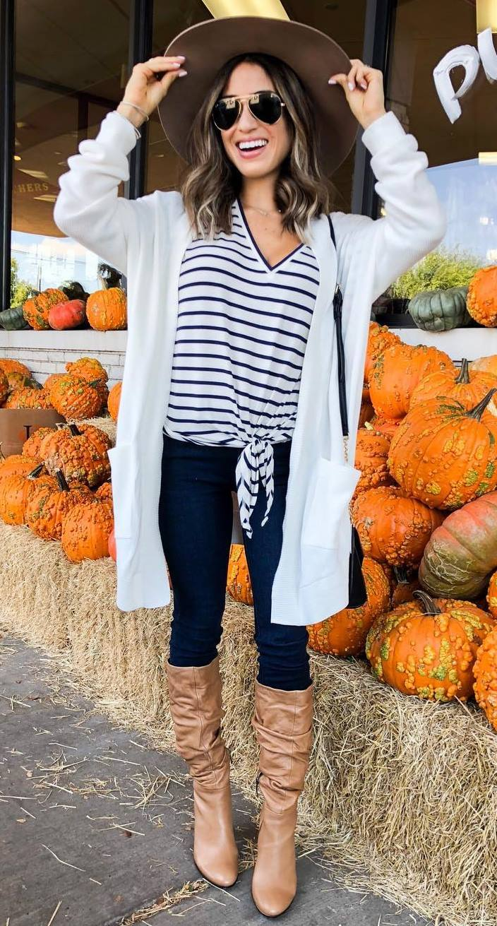 cute outfit idea for this fall / striped top + white cardi + hat + skinny jeans + boots