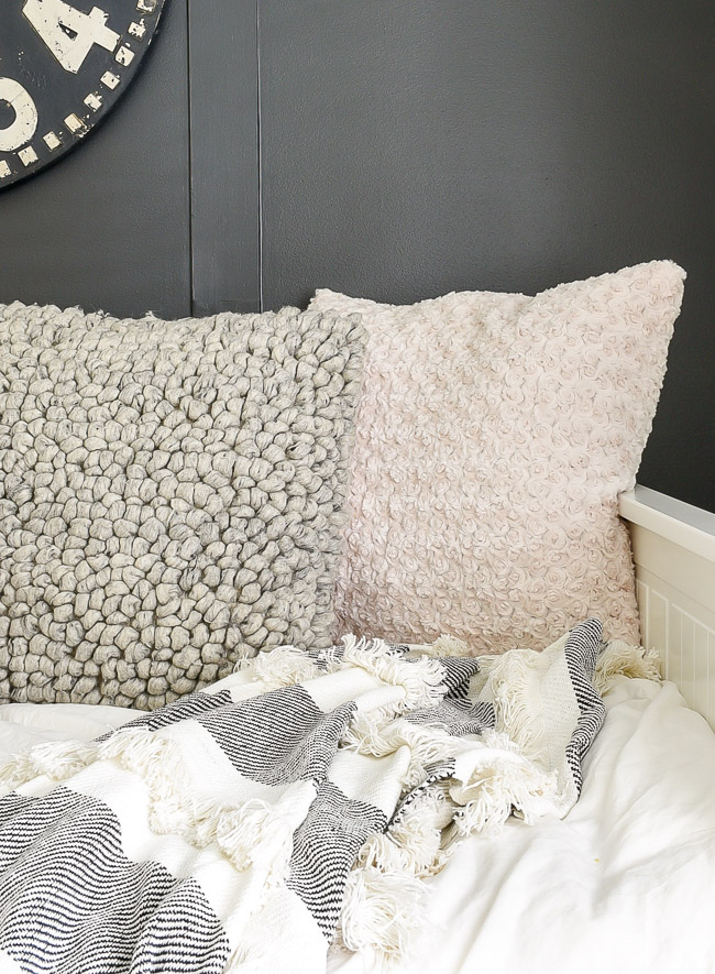 Textured throw pillows on a daybed