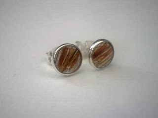 Sterling silver ear studs for locks of hair
