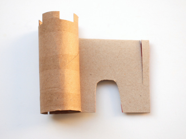attach your cardboard roll tower to your cardboard wall