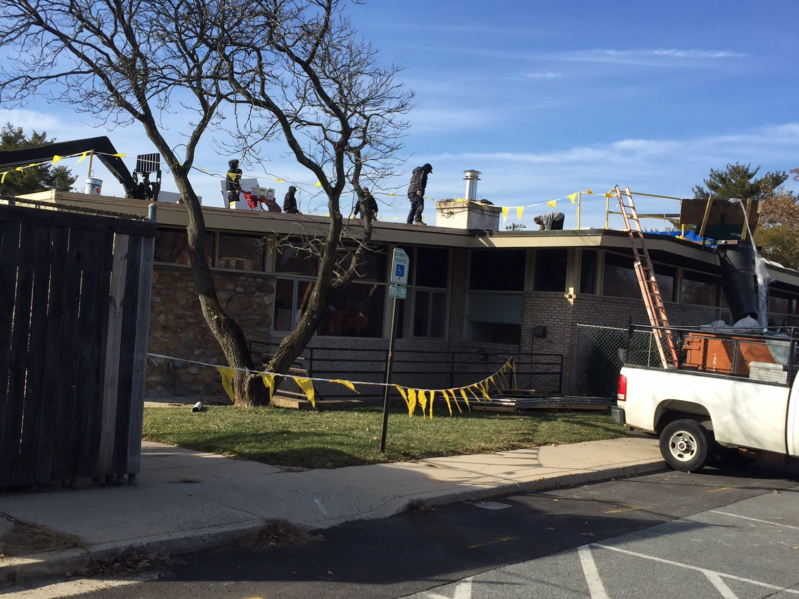 Workers On Davis Roof. Roofing Work.