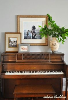 Green street decorating around a piano for Piano room decor