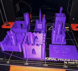 3D printed castles on a print bed