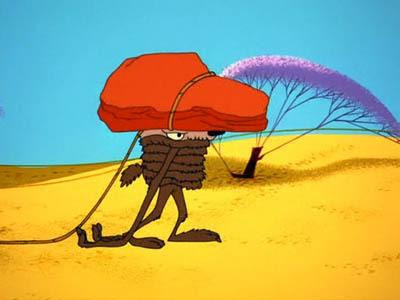 wile coyote crushed by rock