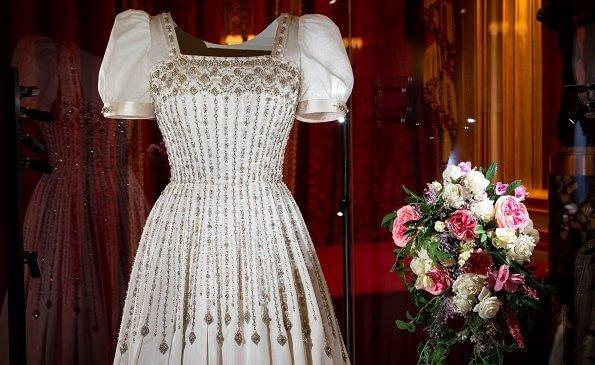 Princess Beatrice wore The Vampire's Wife's floral print silk midi dress, Princess Beatrice's wedding shoes, made by Valentino. wedding dress