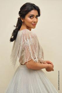 Shriya Saran at atri movie Music launch in a long skirt and cape top by Shriya Som
