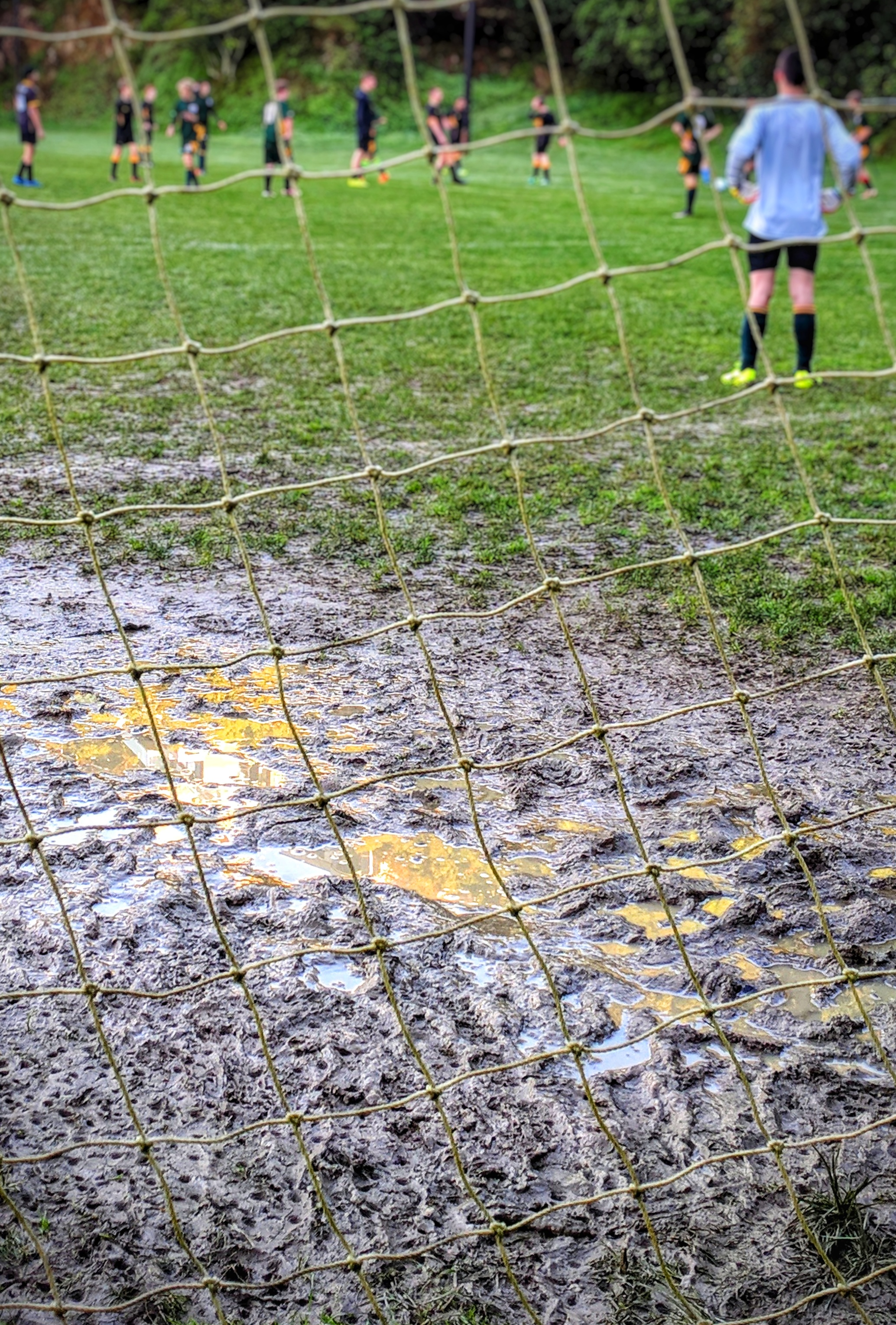 Muddy puddle centre front of the goals