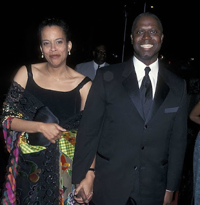 Ami Brabson holding hand with her husband Andre