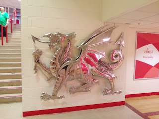Silver dragon on wall to welcome visitors to the stadium