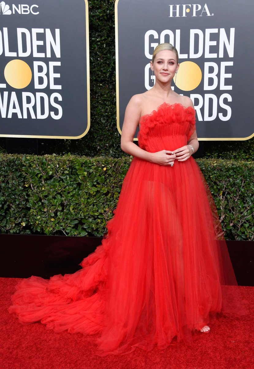 Lili Reinhart Makes Her Golden Globes Debut in a Giant Red Tulle Gown by Khyeli Couture