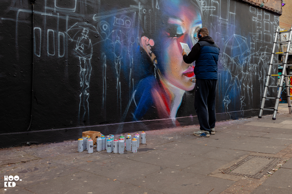 Shoreditch Street Art, London Street Artist Dan Kitchener aka DANK at work on a mural