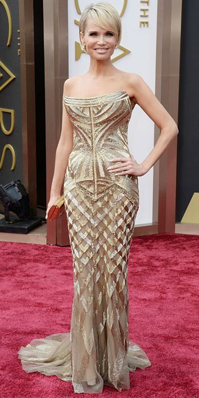 Kristin Chenoweth in a gold Roberto Cavalli gown at the Oscars 2014