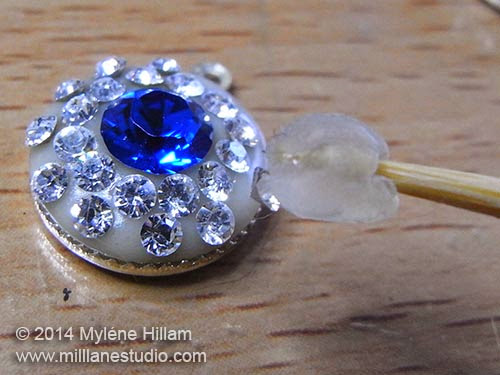 Press the Swarovski crystals into the epoxy resin clay