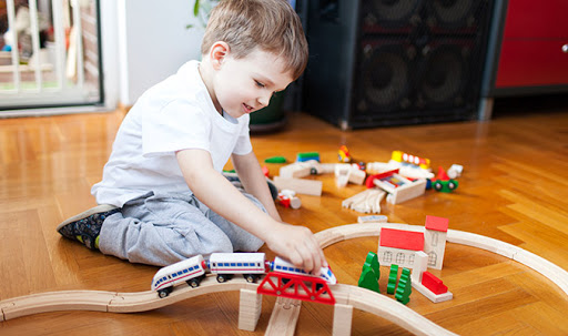 Boy playing with trainset
