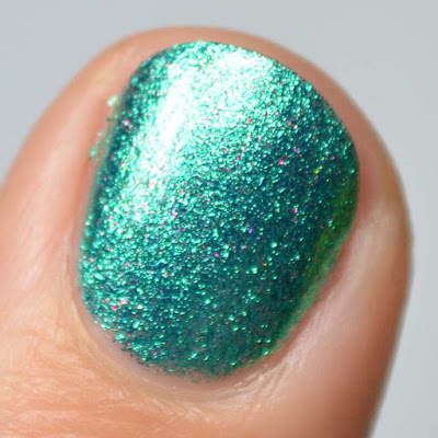 green glitter nail polish swatch