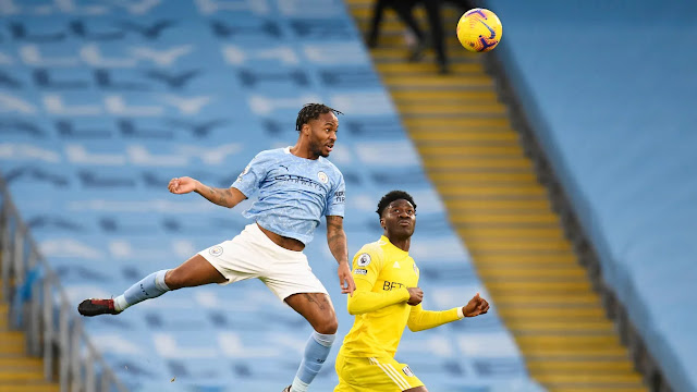 Man city forward Raheem Sterling and Fulham defender Ola Aina in action in the Premier League