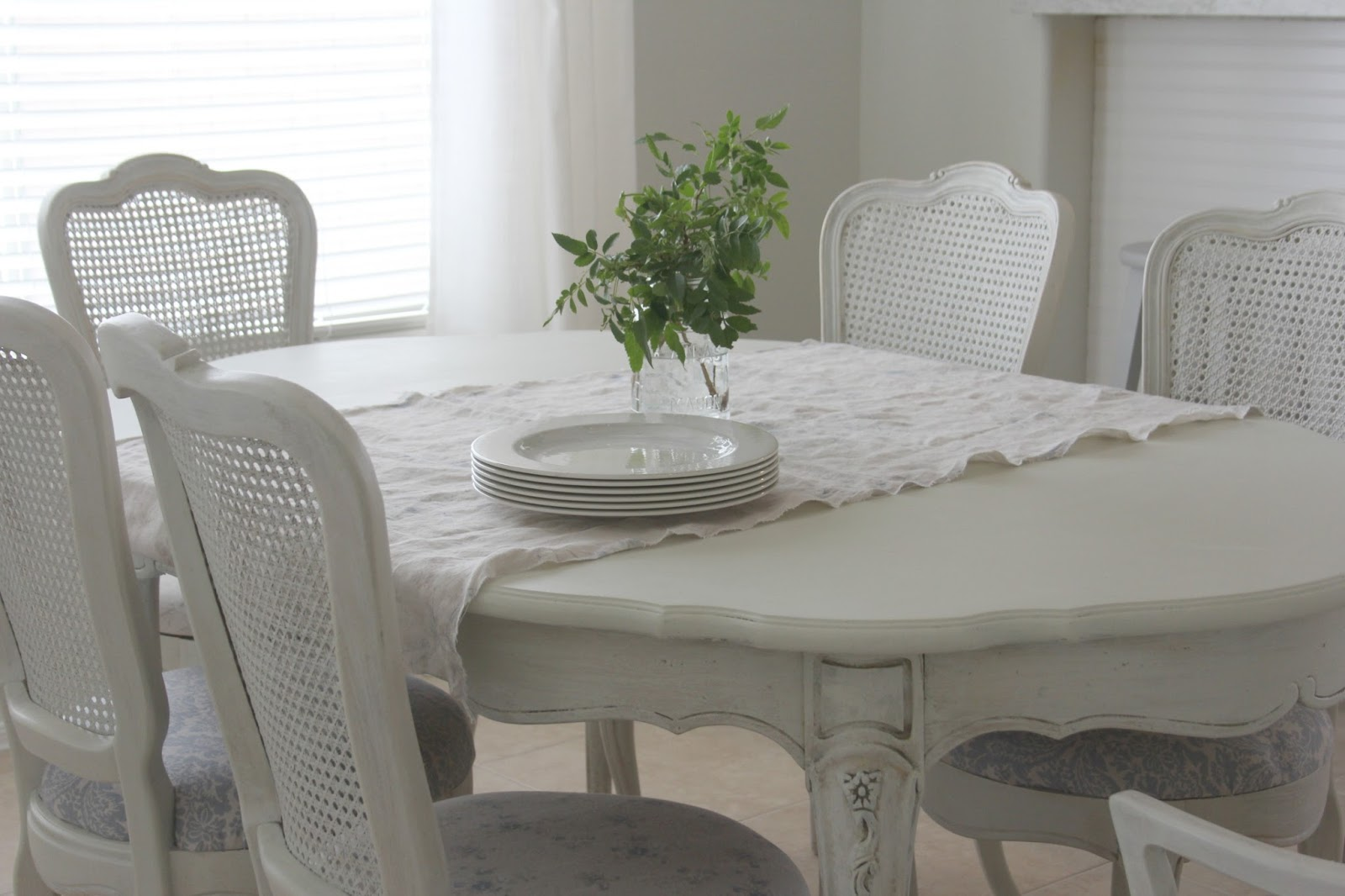Shabby chic white dining room by Hello Lovely Studio