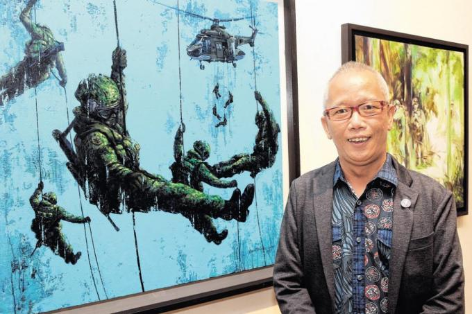 Artist Kevin Tan with his work Vertical Valour, an acrylic painting depicting elite Guardsmen rappelling from helicopters