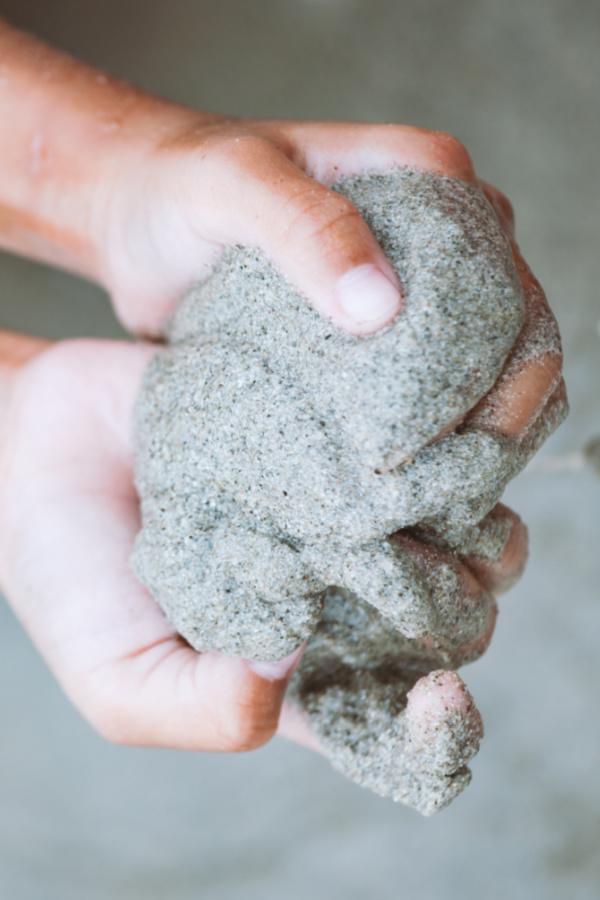 Is a liquid or a solid?  You decide!  Quicksand recipe for play. #quicksand #quicksandrecipe #sandrecipe #sandforkids #growingajeweledrose