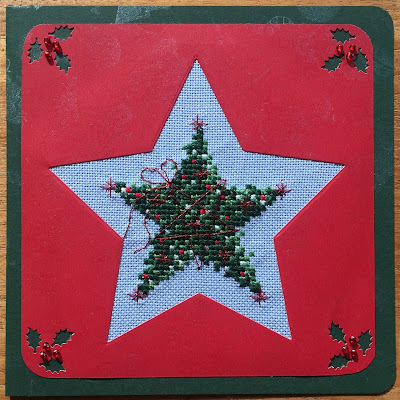 Geborduurde kerstkaart ster