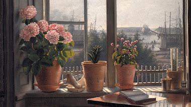 Una ventana abierta y un alfeizar con plantas