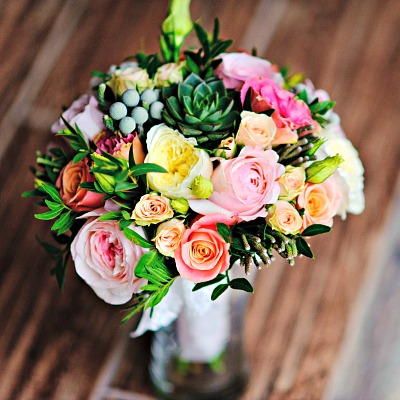 Bouquet of flowers, mostly pale pink and yellow roses
