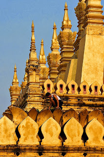 Image of a man standing on the That Luang, Vientiane Laos, from Flickr user Sascha Ricte