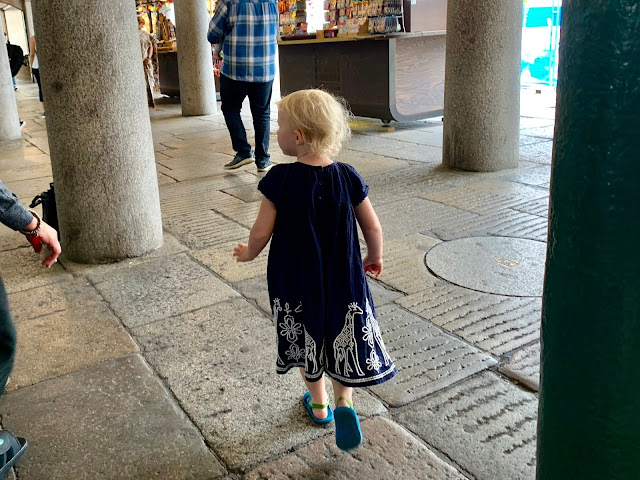 A child visiting covent garden looking for things to do