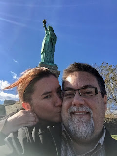 David Brodosi and wife visiting statue of Liberty