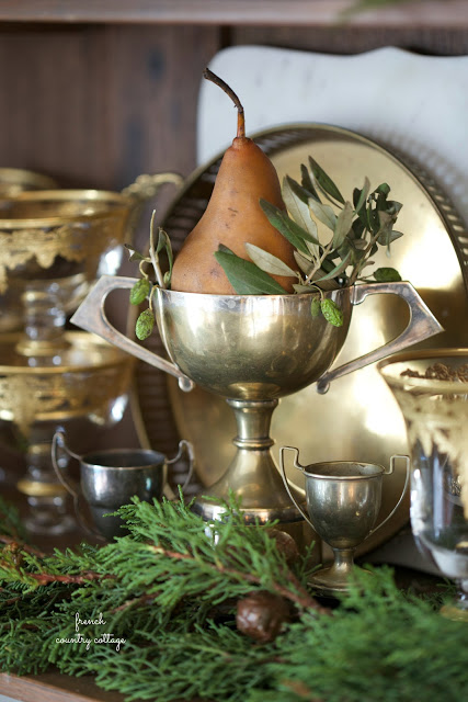 vintage trophy with pear and Christmas greens