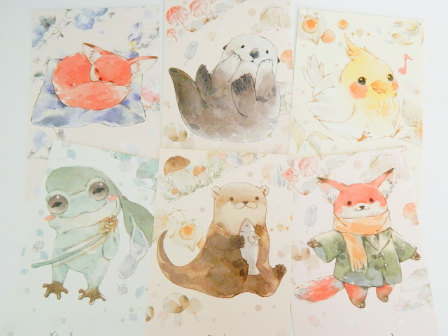 a photo showing six watercolour animal illustration postcards